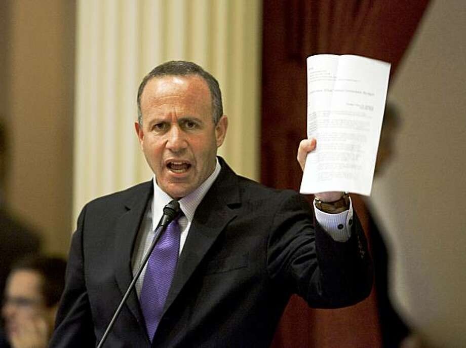 SACRAMENTO, California-Darrell Steinberg (D- Sacramento) president pro tem of the state Senate on the the floor of the state senate Juune 24, 22009, shows a press release announcing the proposal for the state to issue IOU's after July 1 or July 2 if a balanced budget is not passed, With time running out, the state Assembly and state Senate debate meet to close the state's $24 billion deficit. But chances of approval are slim to none with Republicans  balking at the Democrats tax proposals and arguing for deeper cuts. Photo: Robert Durell, Special To The Chronicle