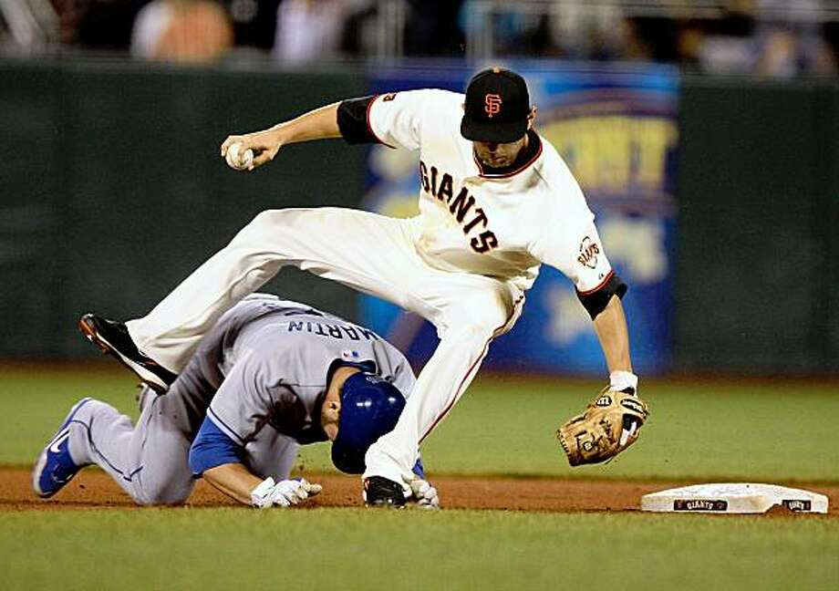 SAN FRANCISCO - AUGUST 10:  Russell Martin #55 of the Los Angeles Dodgers slides into second as Freddy Sanchez #21 of the San Francisco Giants takes the throw on a fielders choice hit by Manny Ramirez in the fifth inning during a Major League Baseball game at AT&T Park on August 10, 2009 in San Francisco, California.  (Photo by Jed Jacobsohn/Getty Images) Photo: Jed Jacobsohn, Getty Images