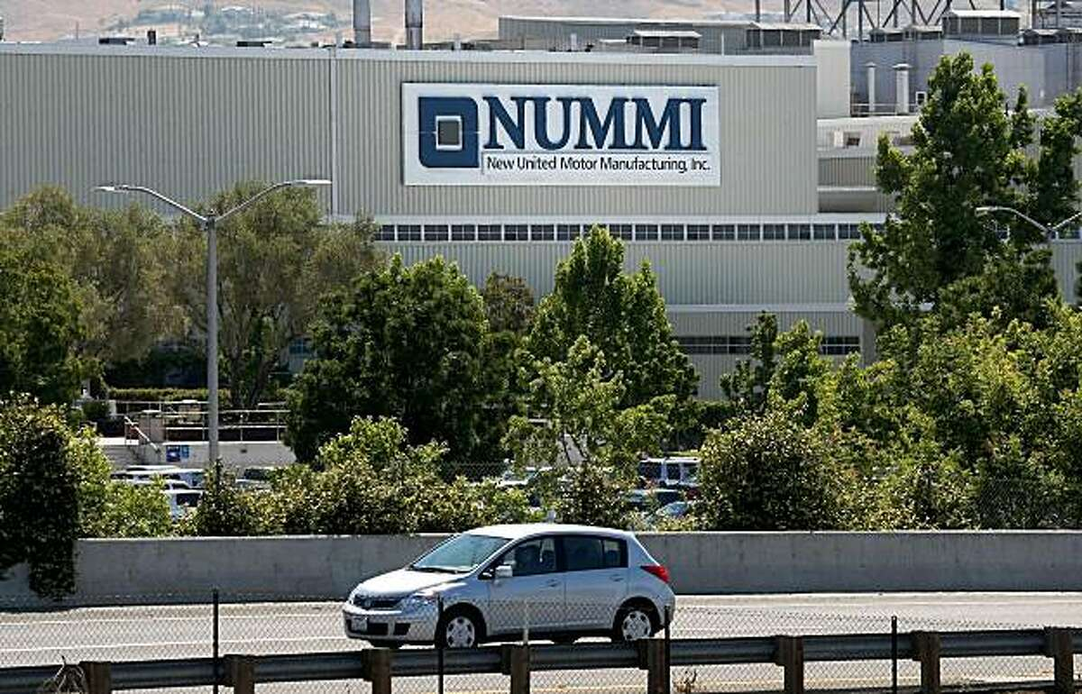 FREMONT, CA - JULY 23: A car drives by the New United Motor Manufacturing Inc. plant July 23, 2009 in Fremont, California. Toyota Motor Corp. announced that it is considering a plan to dissolve its stake in the Nummi plant after General Motors pulled out of the joint venture last month. Nearly 5,000 workers are employed at the auto manufacturing plant. (Photo by Justin Sullivan/Getty Images)