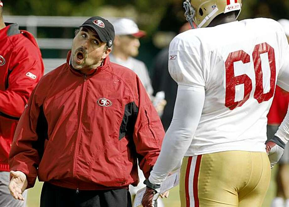 The San Francisco 49ers coach Jim Tomsula has some words for defensive lineman Khalif Mitchell during summer camp practice held at the 49ers headquarters in Santa Clara, Calif., on August 6,  2009. Photo: Frederic Larson, The Chronicle