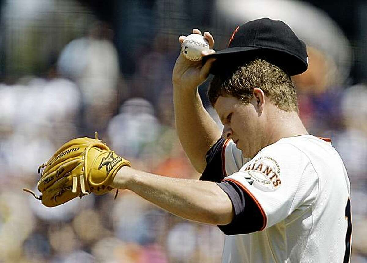 San Francisco Giants' Matt Cain adjusts his cap after giving up a home run to Cincinnati Reds' Brandan Phillips during the first inning of a baseball game Sunday, Aug. 9, 2009, in San Francisco. (AP Photo/Ben Margot)