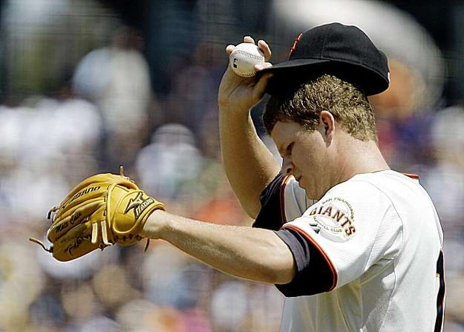 San Francisco Giants' Matt Cain adjusts his cap after giving up a home run to Cincinnati Reds' Brandan Phillips during the first inning of a baseball game Sunday, Aug. 9, 2009, in San Francisco. (AP Photo/Ben Margot) Photo: Ben Margot, AP
