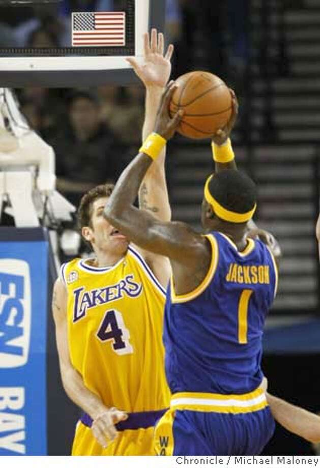 Golden State Warriors Stephen Jackson (1) shoots against Los Angeles Lakers Luke Walton (4) in the first half.  The Golden State Warriors host the Los Angeles Lakers in a NBA game at Oracle Arena in Oakland, Calif., on March 24, 2008.  Photo by Michael Maloney / San Francisco Chronicle Photo: Michael Maloney