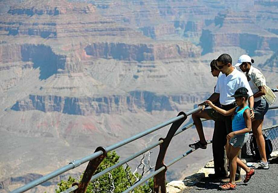 US President Barack Obama, First Lady Michelle Obama and their daughters Sasha and Malia tour Hopi Point at Grand Canyon National Park August 16, 2009 in Arizona.       AFP PHOTO/Mandel NGAN (Photo credit should read MANDEL NGAN/AFP/Getty Images) Photo: Mandel Ngan, AFP/Getty Images