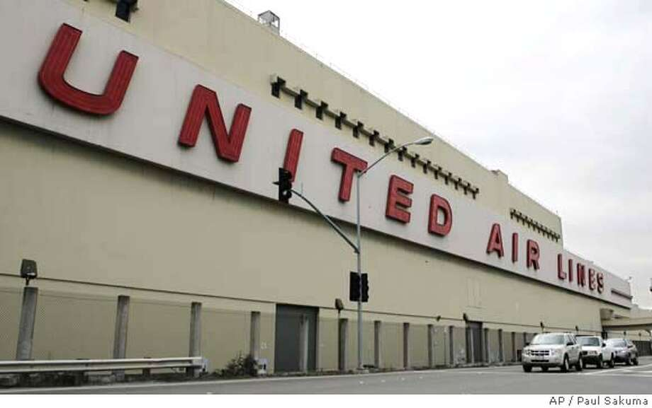 ###Live Caption:The United Airlines maintenance facility at San Francisco International Airport in San Francisco is seen Wednesday, April 2, 2008. United Airlines temporarily grounded 11 percent of its fleet and cancelled 31 flights Wednesday while it tested dozens of Boeing 777s to make sure components of a cargo fire suppression system were operating effectively. (AP Photo/Paul Sakuma)###Caption History:The United Airlines maintenance facility at San Francisco International Airport in San Francisco is seen Wednesday, April 2, 2008. United Airlines temporarily grounded 11 percent of its fleet and cancelled 31 flights Wednesday while it tested dozens of Boeing 777s to make sure components of a cargo fire suppression system were operating effectively. (AP Photo/Paul Sakuma)###Notes:United Airlines###Special Instructions: Photo: Paul Sakuma