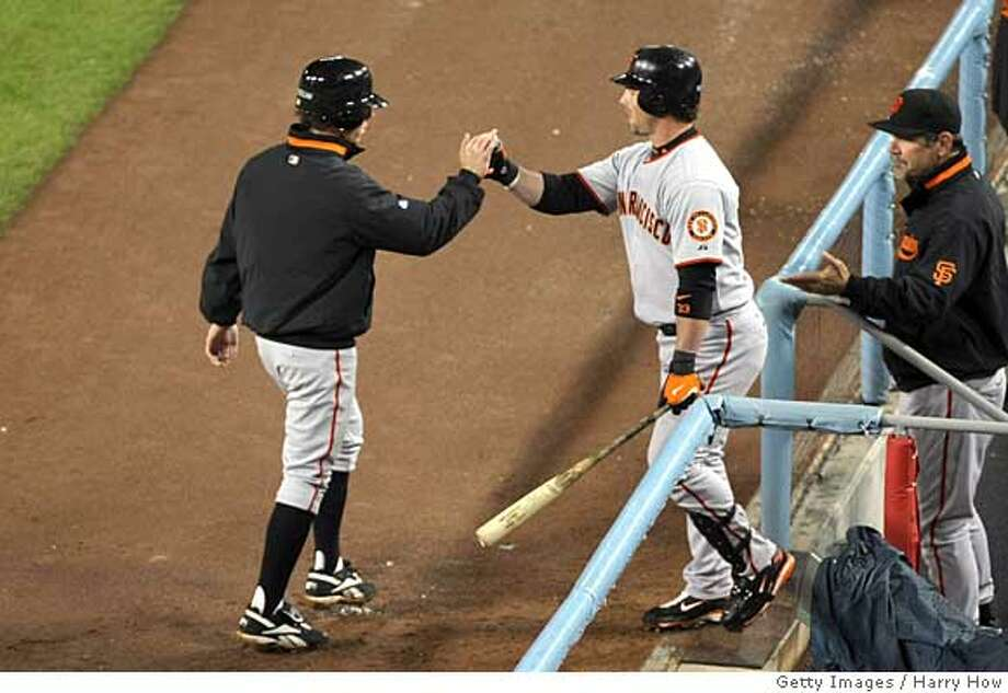 ###Live Caption:LOS ANGELES, CA - APRIL 02: Tim Lincecum #55 of the San Francisco Giants is congratulated by teammate Aaron Rowand #33 after Lincecum scored in the fifth inning of the game against the Los Angeles Dodgers on April 2,2008 at Dodger Stadium in Los Angeles,California. (Photo by Harry How/Getty Images)###Caption History:LOS ANGELES, CA - APRIL 02: Tim Lincecum #55 of the San Francisco Giants is congratulated by teammate Aaron Rowand #33 after Lincecum scored in the fifth inning of the game against the Los Angeles Dodgers on April 2,2008 at Dodger Stadium in Los Angeles,California. (Photo by Harry How/Getty Images)###Notes:San Francisco Giants v Los Angeles Dodgers###Special Instructions: Photo: Harry How