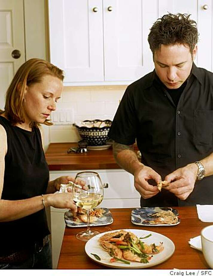 Chef Daniel Dunham of Sebo at home cooking with chef, Melissa Perello. Photo of the two, eating their Shrimp with Toasted Garlic and Chili.Craig Lee / The Chronicle Photo: Craig Lee, SFC