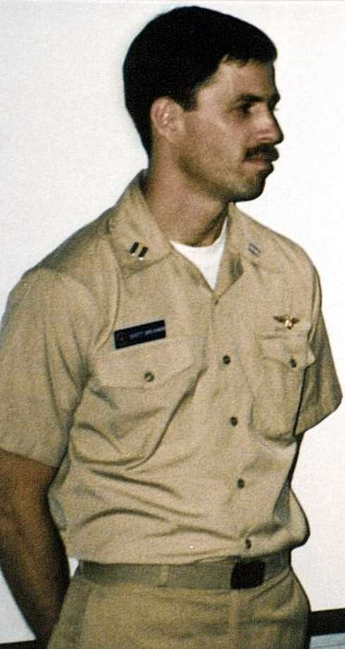 """FILE - This a photo of Michael Scott Speicher made aboard the carrier USS Saratoga in June 18, 1990 when he was promoted to Lt. Commander. Speicher, whose jet fighter went down Jan. 17, 1991 over Iraq, has been missing ever since. Officials said Sunday Aug. 2, 2009, the Armed Forces Institute of Pathology has positively identified the remains of Captain Michael """"Scott"""" Speicher, whose disappearance has bedeviled investigators since his jet was shot down over the Iraq desert on the first night of the war (AP Photo/Barry Hull, File)     NO SALES Photo: Barry Hull, AP"""