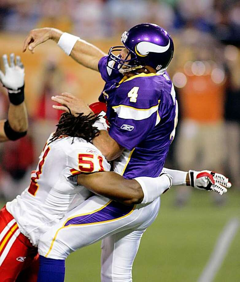 Minnesota Vikings quarterback Brett Favre (4) is hit as he throws by Kansas City Chiefs'  Corie Mays in the first quarter of their NFL preseason football game, Friday,  Aug. 21, 2009 in Minneapolis.(AP Photo/Andy King) Photo: Andy King, AP