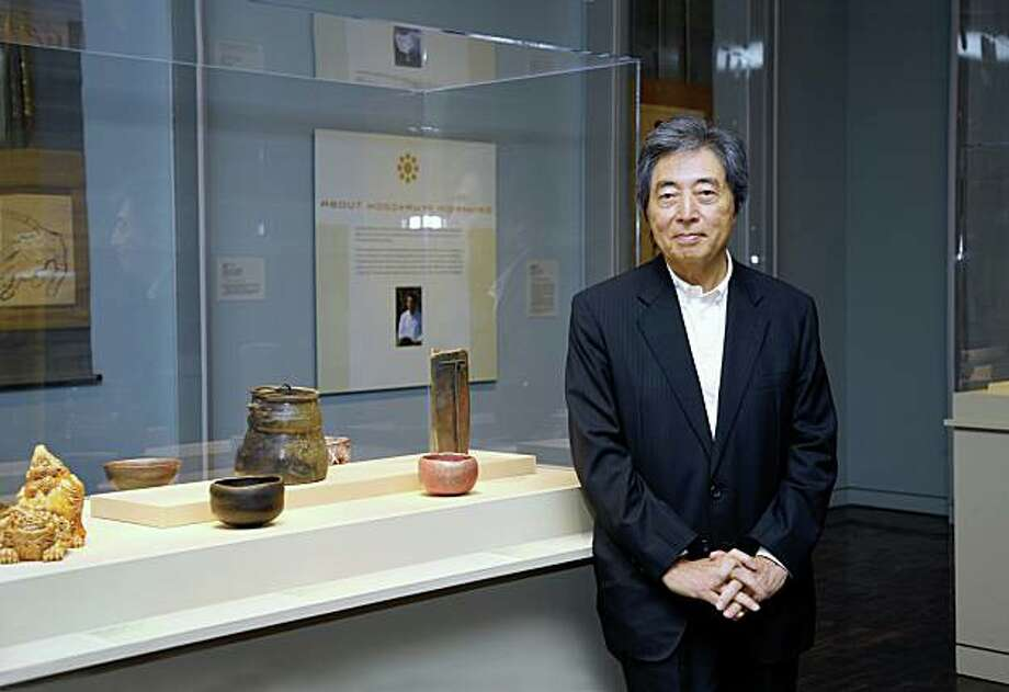 "former Japanese prime minister Morihiro Hosokawa standing next to a display of ceramics made by him in the 2009 exhibition ""Lords of the Samurai"" at the Asian Art Museum, drawn from the Hosokawa family collection of the Eisei Bunko, Tokyo HOSOKAWA Morihiro in ""Lords of the Samurai"" gallery at the Asian Art Musuem of San Francisco, June 12, 2009. Photo by Kas Tsuruta/Asian Art Museum. Photo: Kaz Tsuruta, Asian Art Museum, S.F."