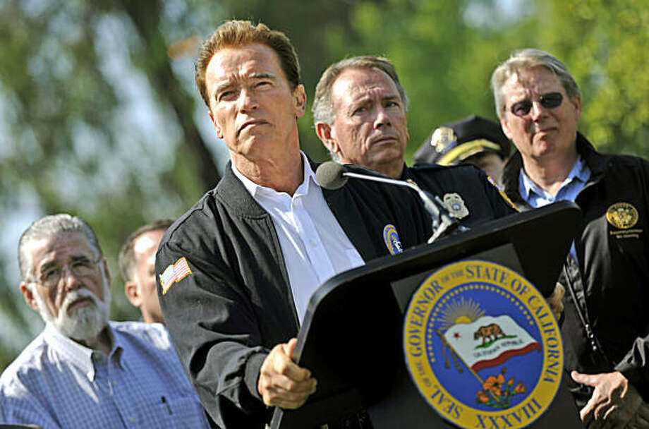 Gov. Schwarzenegger holds a press conference after he was briefed on the status of the Lockheed Fire and the firefighting efforts statewide at the Lockheed Fire Incident Command Post at the Watsonville Fairgrounds in Watsonville, Calif., Saturday, Aug. 15, 2009. Evacuations remain for the communities of Bonny Doon and Swanton.  (AP Photo/Russel A. Daniels) Photo: Russel A. Daniels, AP