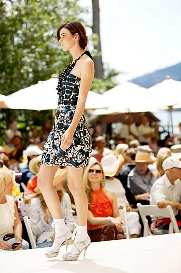 A model walks the runway at the Saks Fifth Avenue and The League to Save Lake Tahoe 40th Anniversary Show with Oscar de la Renta. Runway Photo: Drew Altizer