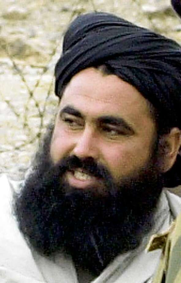"""(FILES) An undated photo from 2004 shows Pakistani Taliban chief Baitullah Mehsud speaking as he arrives for a meeting in South Waziristan. Pakistan said on August 7 it believed that wanted Taliban warlord Baitullah Mehsud was killed in a US drone attack, which if confirmed would score a coup in the US-led fight against Islamist militants. The death of the notorious commander could deal a heavy blow to the sizeable Taliban movement commanded by Mehsud, who has a five-million-dollar US bounty on his head after Washington branded him """"a key Al-Qaeda facilitator"""". Tribesmen said on condition of anonymity that Mehsud was killed with his wife when a US drone fired two missiles into a family home in the Laddah area of South Waziristan on August 5. AFP PHOTO/A MAJEED (Photo credit should read A Majeed/AFP/Getty Images) Photo: A Majeed, AFP/Getty Images"""