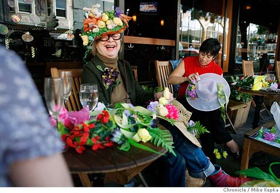 ###Live Caption:theCity Exposed welcoming party A recent Saturday 3:10 p.m.: As puzzled faces walk by, Ruby MacKenzie, squinting through her signature cat eye glasses, laughs almost uncontrollably after draining a second mimosa outside dellÕuva in Northbeach. Her mission is to inspire a sense of spirit in the neighborhood sheÕs lived in for the past 25 years. On a whim she and the girls decided to welcome spring with an impromptu Easter-bonnet-making party. They adorned floppy hats with dollar store birdies and hideous plastic flowers. ÒIt makes people smile what could be better,Ó she said. To hear audio and see more photos, go to sfgate.com/cityexposed.  E-mail Mike Kepka at mkepka@sfchronicle.com  Photo by Mike Kepka / San Francisco Chronicle###Caption History:theCity Exposed welcoming party A recent Saturday 3:10 p.m.: As puzzled faces walk by, Ruby MacKenzie, squinting through her signature cat eye glasses, laughs almost uncontrollably after draining a second mimosa outside dell�uva in Northbeach. Her mission is to inspire a sense of spirit in the neighborhood she�s lived in for the past 25 years. On a whim she and the girls decided to welcome spring with an impromptu Easter-bonnet-making party. They adorned floppy hats with dollar store birdies and hideous plastic flowers. �It makes people smile what could be better,� she said. To hear audio and see more photos, go to sfgate.com/cityexposed.  E-mail Mike Kepka at mkepka@sfchronicle.com  Photo by Mike Kepka / San Francisco Chronicle###Notes:(cq)###Special Instructions:MANDATORY CREDIT FOR PHOTOG AND SAN FRANCISCO CHRONICLE/NO SALES-MAGS OUT Photo: Mike Kepka