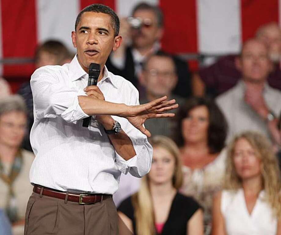 """In this Aug. 15, 2009, President Barack Obama talks about health care during a town hall meeting in Grand Junction, Colo. Obama's weekend concession on a health care """"government option"""" drew complaints from liberals and scarce interest from Republicans and other critics on Monday, Aug. 17, 2009, a fresh sign of the challenge the administration confronts in finding middle ground in an increasingly partisan political struggle. (AP Photo/Ed Andrieski) Photo: Ed Andrieski, AP"""