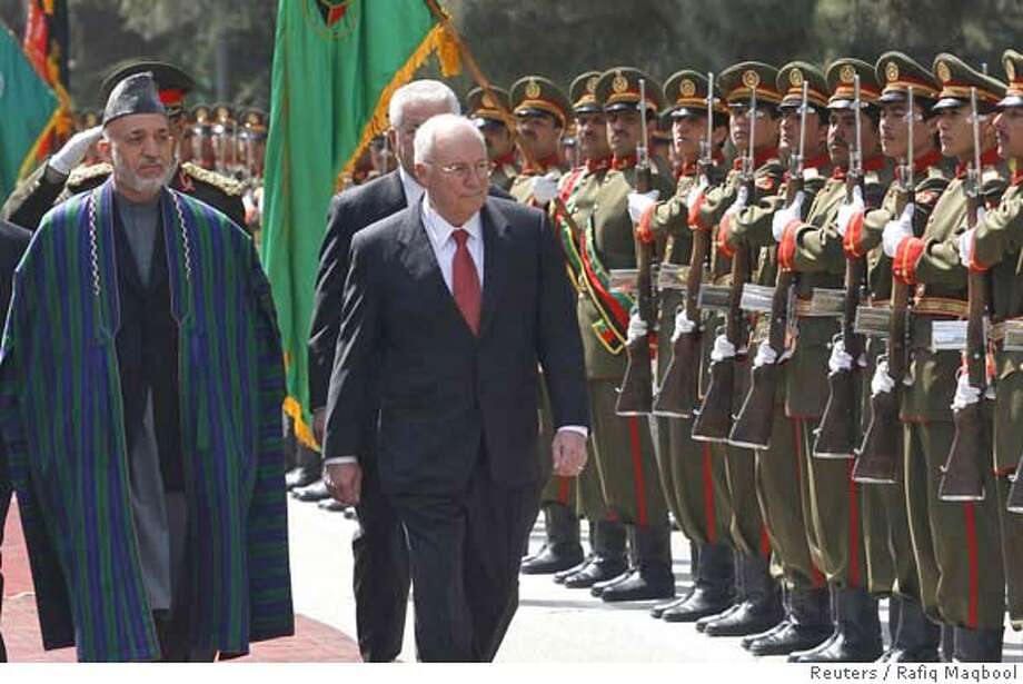 ###Live Caption:Afghan President Hamid Karzai (L) and U.S. Vice-President Dick Cheney inspect the guard of honour at the presidential palace in Kabul, March 20, 2008. Cheney visited Afghanistan on Thursday and met President Karzai ahead of a NATO summit where Washington will urge its allies to send more troops to the war-torn country. REUTERS/Rafiq Maqbool/Pool (AFGHANISTAN)###Caption History:Afghan President Hamid Karzai (L) and U.S. Vice-President Dick Cheney inspect the guard of honour at the presidential palace in Kabul, March 20, 2008. Cheney visited Afghanistan on Thursday and met President Karzai ahead of a NATO summit where Washington will urge its allies to send more troops to the war-torn country. REUTERS/Rafiq Maqbool/Pool (AFGHANISTAN)###Notes:Afghan President Hamid Karzai and U.S. Vice-President Dick Cheney inspect the guard of honour at the presidential palace in Kabul###Special Instructions:0 Photo: POOL