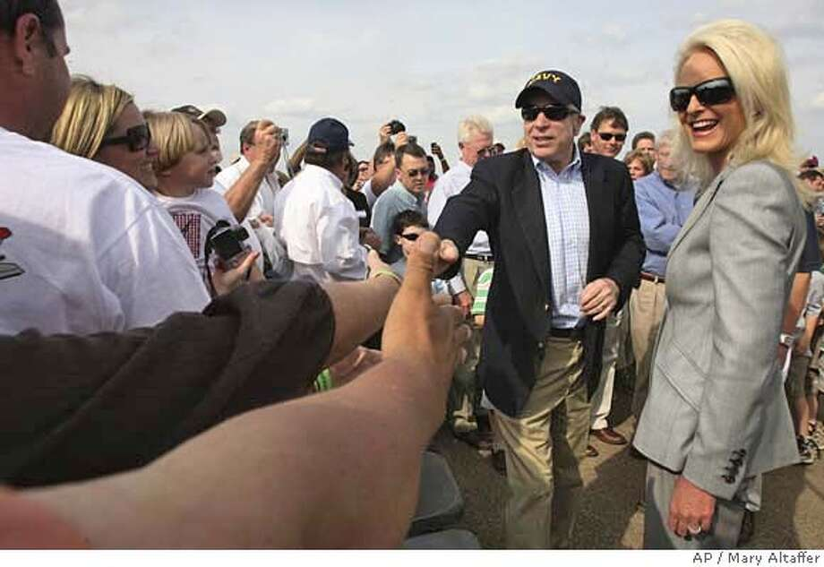 "###Live Caption:Republican presidential candidate, Sen. John McCain, R-Ariz., center, accompanied by his wife, Cindy, right, greets the crowd at the ""Wings over Meridian"" Air Show at the McCain field on the Meridian Naval Air Station Sunday, March 30, 2008 in Meridian, Miss. (AP Photo/Mary Altaffer)###Caption History:Republican presidential candidate, Sen. John McCain, R-Ariz., center, accompanied by his wife, Cindy, right, greets the crowd at the ""Wings over Meridian"" Air Show at the McCain field on the Meridian Naval Air Station Sunday, March 30, 2008 in Meridian, Miss. (AP Photo/Mary Altaffer)###Notes:John McCain###Special Instructions: Photo: Mary Altaffer"