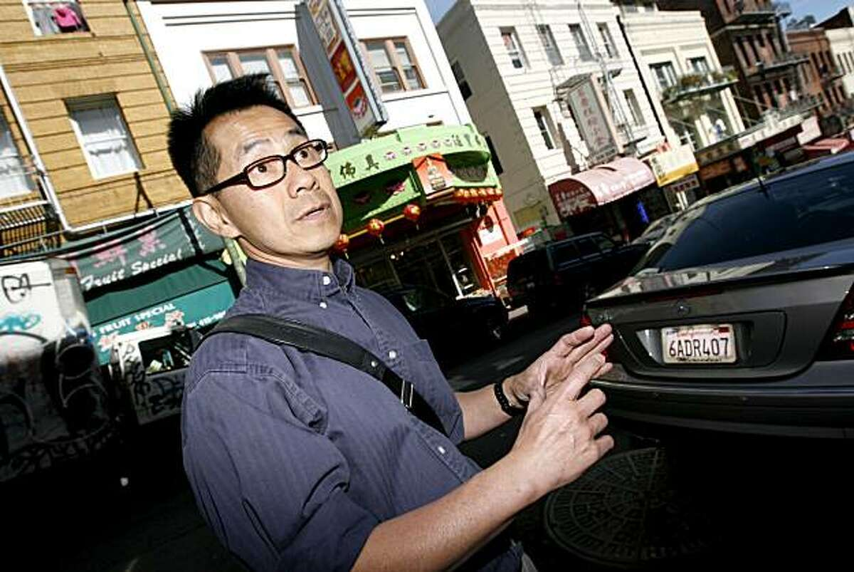 With the old Grandview Theater, now called King Exquisite, Inc., behind him, Arthur Dong, a filmmaker who grew up in San Francisco's Chinatown and North Beach, tells about seeing films there as a child. Arthur has made a documentary film called