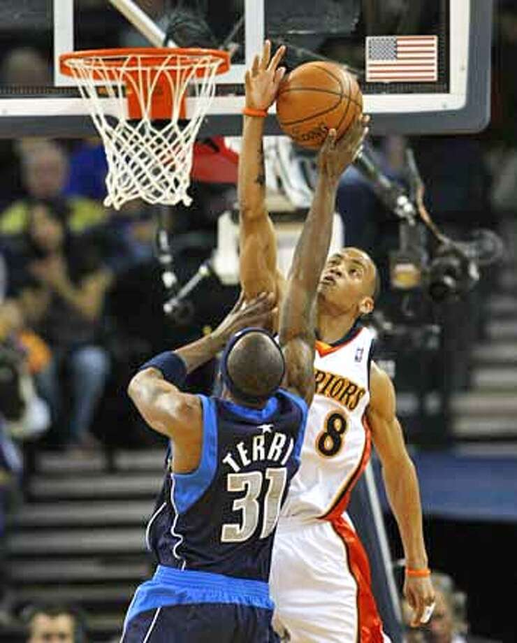 Golden State Warriors Monta Ellis (8) blocks a shot attempt by Dallas Mavericks Jason Terry (31) in the first half.  The Golden State Warriors host the Dallas Mavericks in a NBA game at Oracle Arena in Oakland, Calif., on March 30, 2008.  Photo by Michael Maloney / San Francisco Chronicle Photo: Michael Maloney