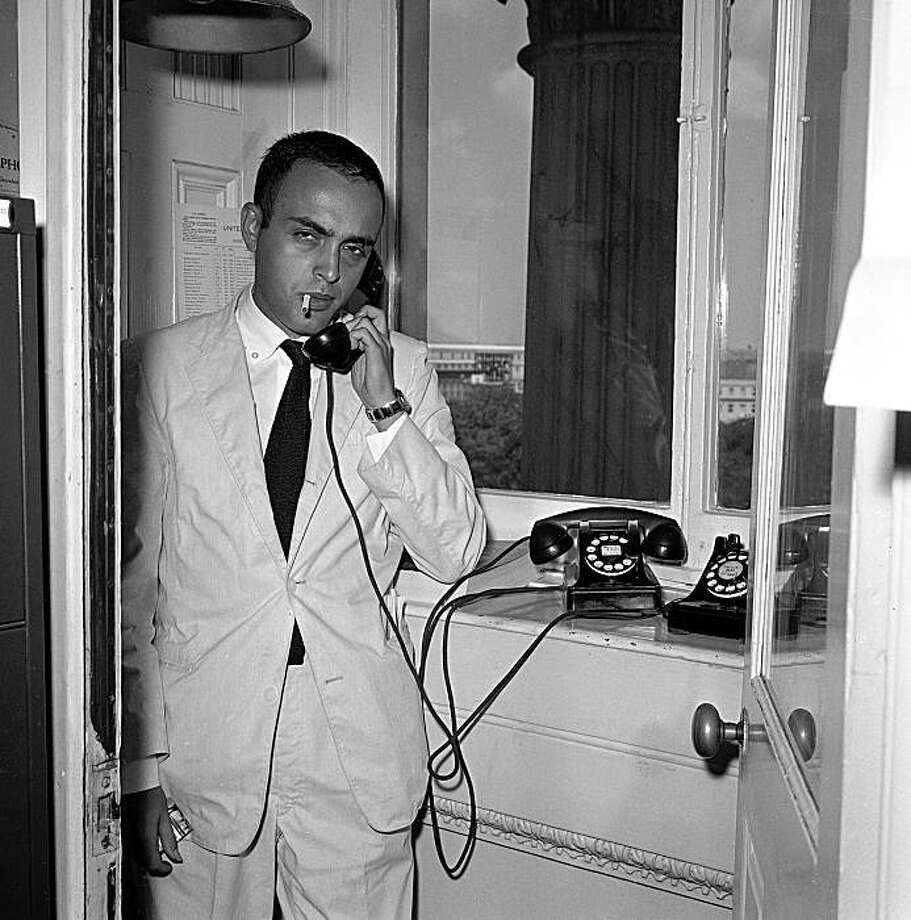 Associated Press staff reporter Robert Novak is shown at work as he talks on the telephone in the Senate Press Gallery on Capitol Hill in Washington on Aug. 15, 1958. Photo: Henry Griffin, AP