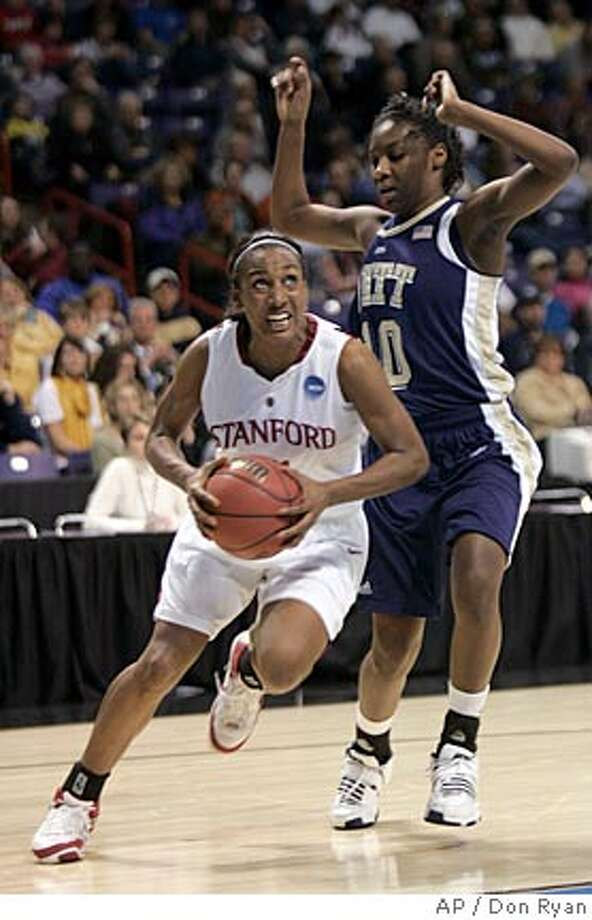 Stanford guard Candice Wiggins, left, drives to the hoop against Pittsburgh guard Taneisha Harrison during the first half of an NCAA women's basketball Spokane Regional tournament semifinals in Spokane, Wash., Saturday, March 29, 2008. (AP Photo/Don Ryan) Photo: Don Ryan