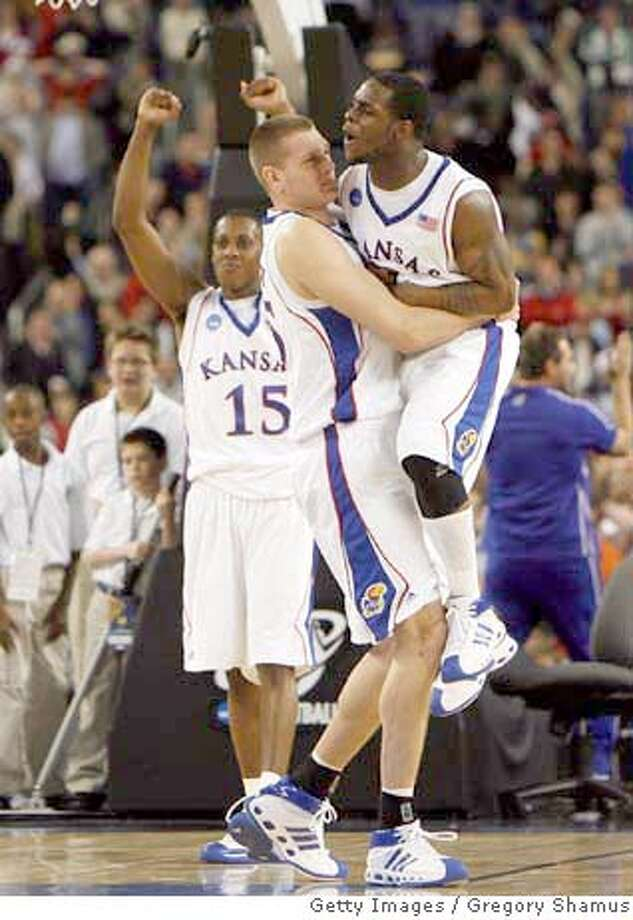 ###Live Caption:DETROIT - MARCH 30: (L-R) Mario Chalmers #15, Cole Aldrich #45 and Sherron Collins #4 of the Kansas Jayhawks celebrate their 59-57 win against the Davidson Wildcats against the Kansas Jayhawks during the Midwest Regional Final of the 2008 NCAA Division I Men's Basketball Tournament at Ford Field on March 30, 2008 in Detroit, Michigan (Photo by Gregory Shamus/Getty Images)###Caption History:DETROIT - MARCH 30: (L-R) Mario Chalmers #15, Cole Aldrich #45 and Sherron Collins #4 of the Kansas Jayhawks celebrate their 59-57 win against the Davidson Wildcats against the Kansas Jayhawks during the Midwest Regional Final of the 2008 NCAA Division I Men's Basketball Tournament at Ford Field on March 30, 2008 in Detroit, Michigan (Photo by Gregory Shamus/Getty Images)###Notes:Davidson v Kansas###Special Instructions: Photo: Gregory Shamus