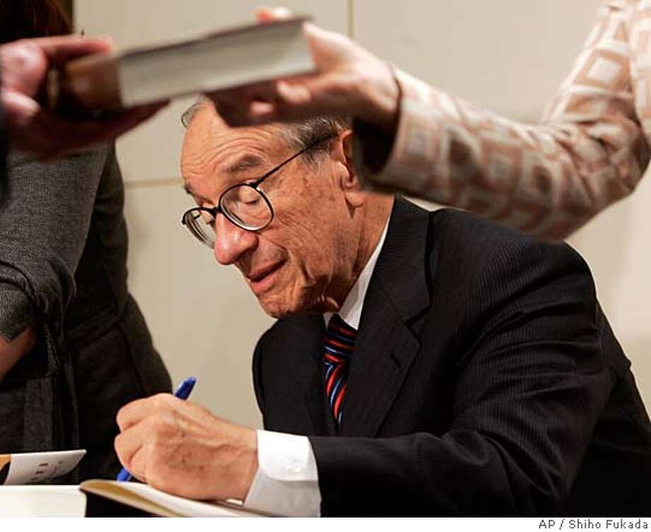 Former Federal Reserve Chairman Alan Greenspan signs his book 'The Age of Turbulence: Adventures in a New World' in New York, Monday, Sept. 17, 2007. (AP Photo/Shiho Fukada) Photo: Shiho Fukada