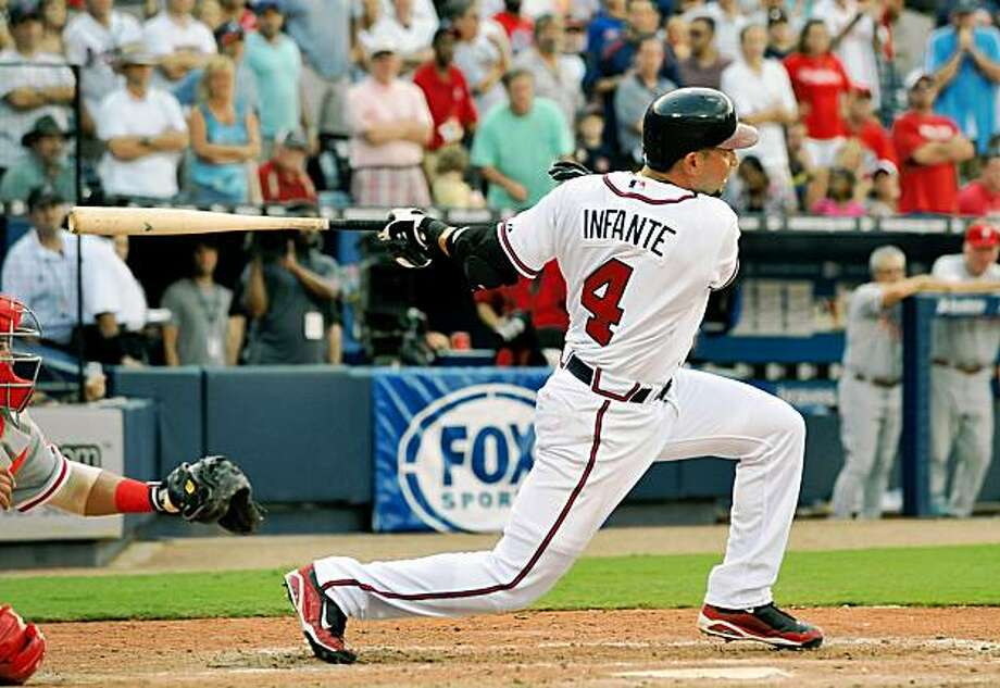 Atlanta Braves' Omar Infante (4) watches his game-winning base hit against the Philadelphia Phillies during the ninth inning of a baseball game, Saturday, Aug. 15, 2009, at Turner Field in Atlanta. The Braves won 4-3. (AP Photo/Gregory Smith) Photo: Gregory Smith, AP