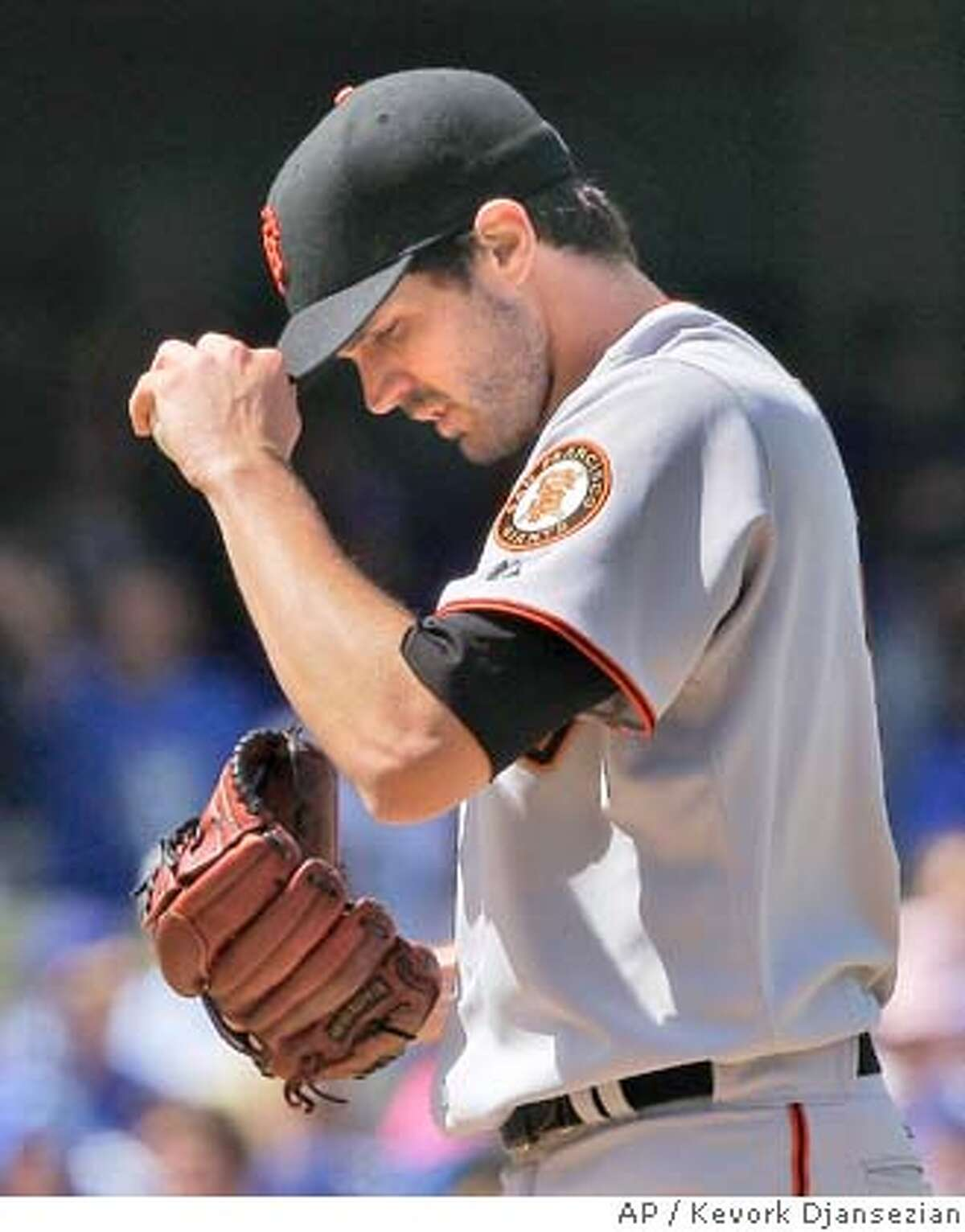 San Francisco Giants Barry Zito reacts as he pitches to Los Angeles Dodgers' Andruw Jones after giving up a two run homer to Jeff Kent during the first inning of the baseball game at Dodger Stadium in Los Angeles Monday, March 31, 2008. (AP Photo/Kevork Djansezian)