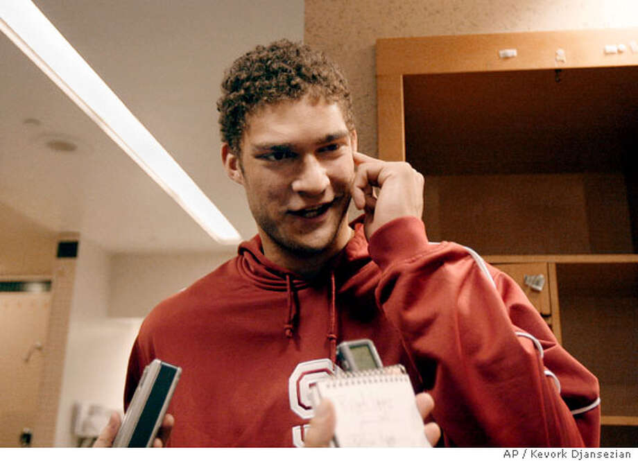 Stanford center Brook Lopez speaks in the locker room before practice on Friday, March 21, 2008 in Anaheim, Calif. Stanford will take on Marquette for their second round basketball game at the NCAA South Regional. (AP Photo/Kevork Djansezian) Photo: Kevork Djansezian