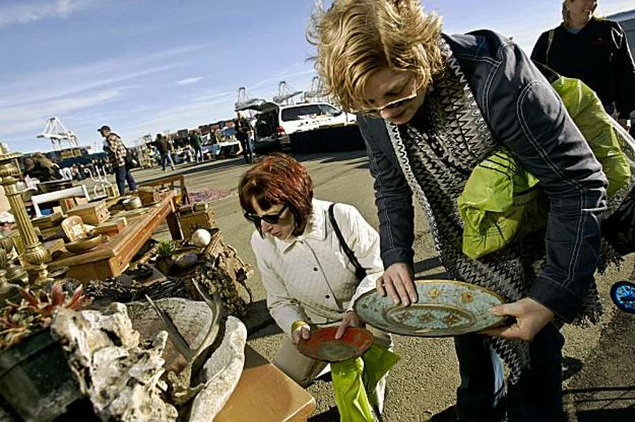 Vanessa Murphy (L)  and Kelley Flynn look over items at the Alameda Antiques and Collectibles Faire,  Sunday, March 2, 2008 in Alameda, California.  Photo by David Paul Morris / The Chronicle Photo: David Paul Morris, The Chronicle
