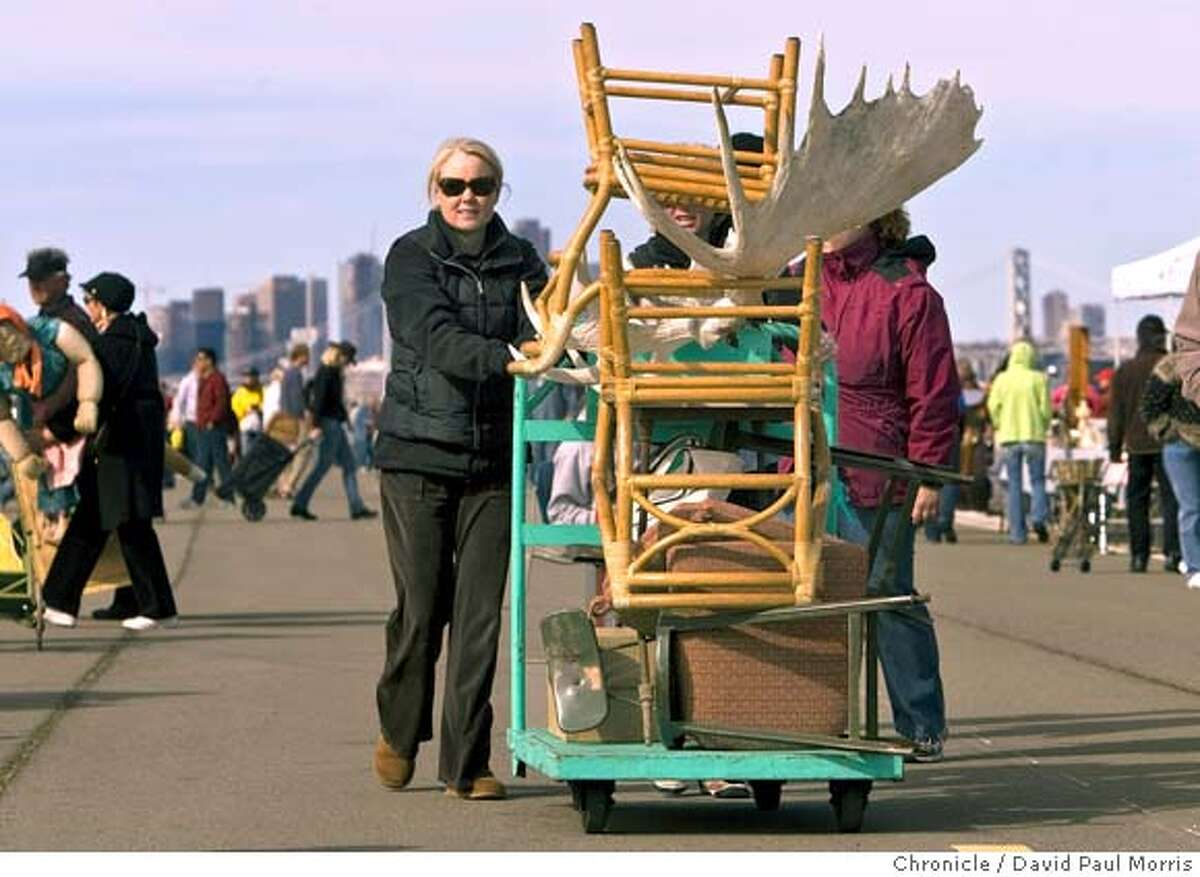 ###Live Caption:Sasha Mock of Sausalito pushes her cart of recent purchases at the Alameda Antiques and Collectibles Faire, Sunday, March 2, 2008 in Alameda, California. Photo by David Paul Morris / The Chronicle###Caption History:Sasha Mock of Sausalito pushes her cart of recent purchases at the Alameda Antiques and Collectibles Faire, Sunday, March 2, 2008 in Alameda, California. Photo by David Paul Morris / The Chronicle###Notes:**Sasha Mock###Special Instructions:MANDATORY CREDIT FOR PHOTOGRAPHER AND SAN FRANCISCO CHRONICLE/NO SALES-MAGS OUT