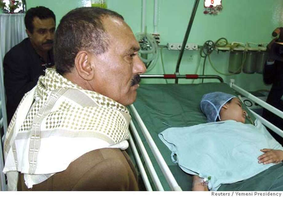 "###Live Caption:Yemeni President Ali Abdullah Saleh visits an injured schoolgirl after mortar rounds struck the courtyard of a school next to the U.S. embassy in Sanaa March 18, 2008. The target of the attack, which the Interior Ministry said wounded five embassy guards and 13 schoolgirls, is not immediately clear but a U.S. State Department spokesman said the embassy was a ""potential target"". REUTERS/Yemeni Presidency/Handout (YEMEN). FOR EDITORIAL USE ONLY. NOT FOR SALE FOR MARKETING OR ADVERTISING CAMPAIGNS.###Caption History:Yemeni President Ali Abdullah Saleh visits an injured schoolgirl after mortar rounds struck the courtyard of a school next to the U.S. embassy in Sanaa March 18, 2008. The target of the attack, which the Interior Ministry said wounded five embassy guards and 13 schoolgirls, is not immediately clear but a U.S. State Department spokesman said the embassy was a ""potential target"". REUTERS/Yemeni Presidency/Handout (YEMEN). FOR EDITORIAL USE ONLY. NOT FOR SALE FOR MARKETING OR ADVERTISING CAMPAIGNS.###Notes:Yemeni President Saleh visits an injured schoolgirl after mortar rounds struck the courtyard of a school next to the U.S. embassy in Sanaa###Special Instructions:EUO Photo: HO"