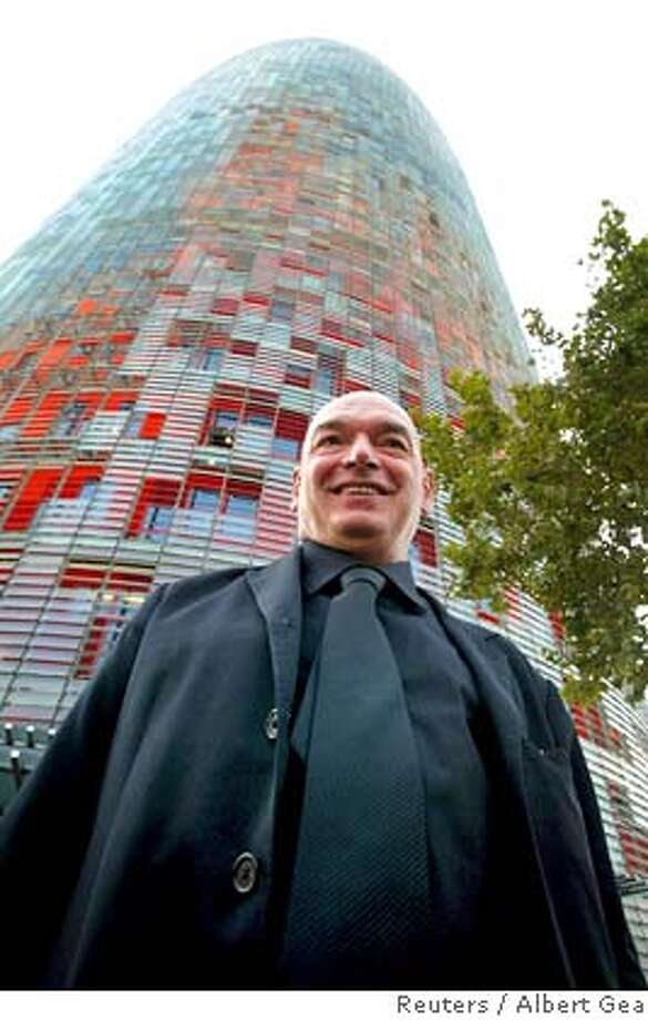 French architect Jean Nouvel poses after the inauguration of the new Agbar Tower in Barcelona in this September 15, 2005 file photo. Nouvel has been awarded the 2008 Pritzker Prize, the highest honor for architecture, for his creative experimentation and buildings that speak to their surroundings, the Pritzker jury said March 30, 2008. REUTERS/Albert Gea/Files (SPAIN) Photo: ALBERT GEA