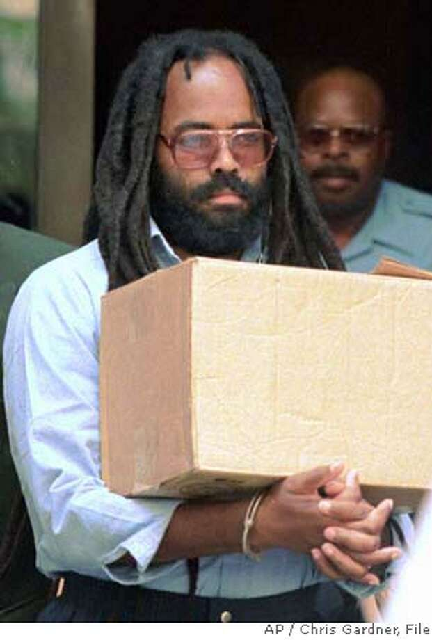 ###Live Caption:**FILE** Mumia Abu-Jamal, convicted of killing Philadelphia police officer Daniel Faulkner in 1981, leaves a Philadelphia court July 12, 1995. A federal appeals court has upheld Abu-Jamal's conviction for murdering a Philadelphia police officer in 1981, but agreed with a lower court that he cannot be executed without a new penalty hearing. (AP Photo/Chris Gardner, File)###Caption History:**FILE** Mumia Abu-Jamal, convicted of killing Philadelphia police officer Daniel Faulkner in 1981, leaves a Philadelphia court July 12, 1995. A federal appeals court has upheld Abu-Jamal's conviction for murdering a Philadelphia police officer in 1981, but agreed with a lower court that he cannot be executed without a new penalty hearing. (AP Photo/Chris Gardner, File)###Notes:Mumia Abu-Jamal###Special Instructions:JULY 12, 1995 FILE PHOTO Photo: CHRIS GARDNER