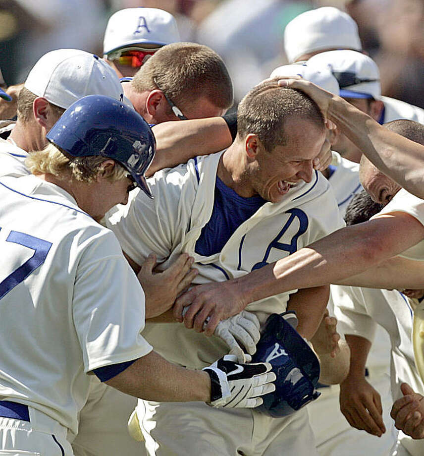 Oakland Athletics' Mark Ellis is mobbed by teammates after hitting a walk-off home run off Chicago White Sox' Bobby Jenks in the ninth inning of a baseball game Sunday, Aug. 16, 2009, in Oakland, Calif. (AP Photo/Ben Margot) Photo: Ben Margot, AP