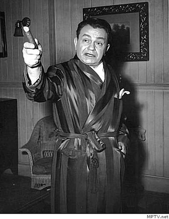 "Edward G. Robinson on the set of ""Key Largo"" in 1948 Photo: MPTV.net"