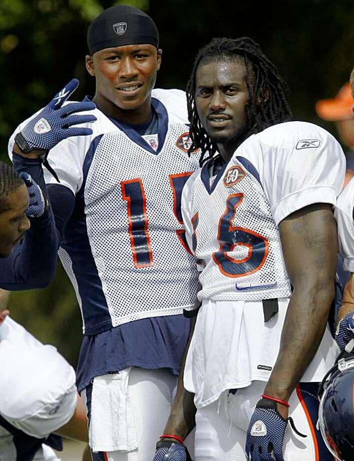 Denver Broncos wide receiver Brandon Marshall, left, acknowledges photographers as wide receiver Chad Jackson looks on during a break in drills at  NFL football training camp at team's headquarters on Tuesday, Aug. 18, 2009, in Englewood, Colo. (AP Photo/David Zalubowski) Photo: David Zalubowski, AP
