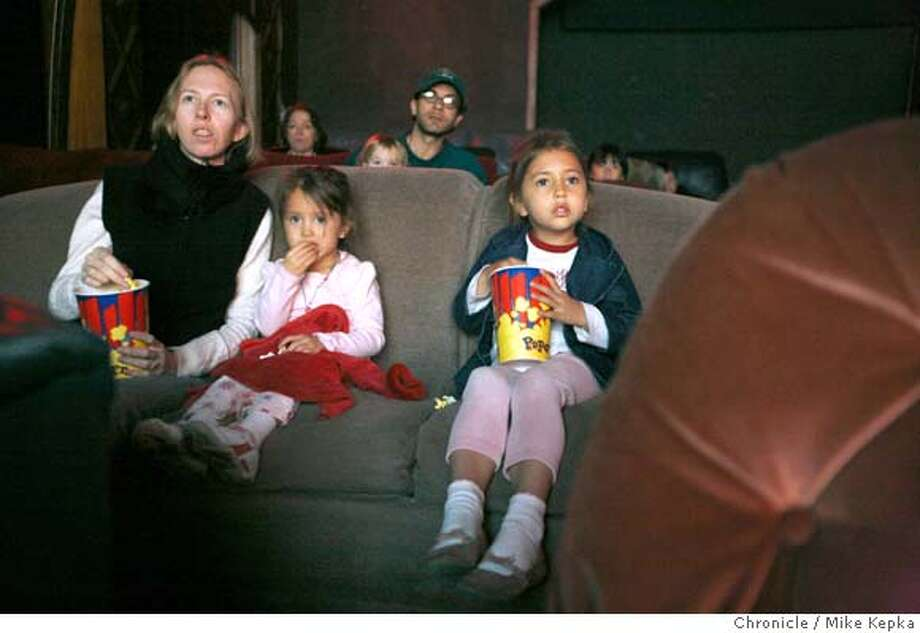 Gidget Valadez and her daughters Hali Valadez, 3, and Rachel Valadez, 5, watch a late morning screening of Horton Hears a Who at The Alameda Central Cinema on Thursday, March 27, 2008 in Alameda, Calif. Theater owner, Mark Haskett turned the former funeral home into a theater in 2004 and now exclusively runs movies geared towards families. Photo by Mike Kepka / San Francisco Chronicle Photo: Mike Kepka