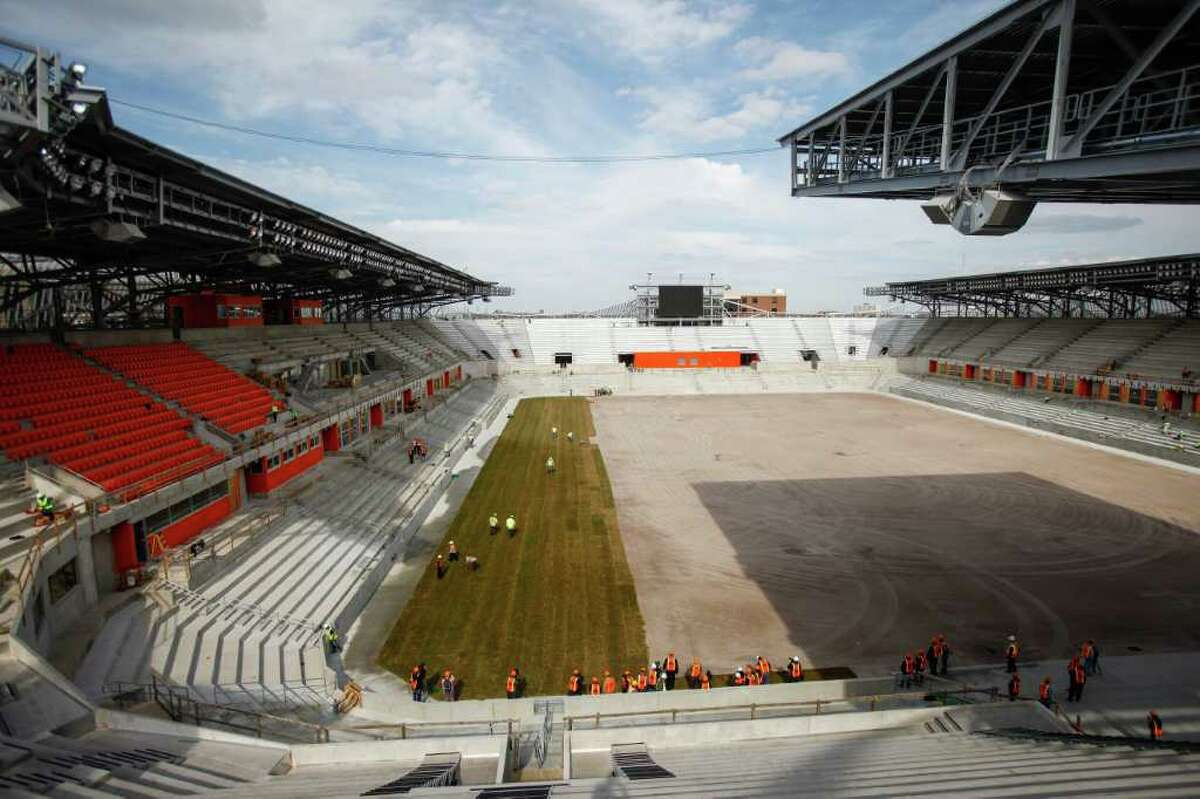 Seat installation and sod laying continues at the BBVA Compass Stadium where the Houston Dynamo soccer team will soon be playing, Wednesday, Feb. 8, 2012, in Houston. The state-of-the-art, open-air stadium is designed to host Dynamo matches as well as additional sporting and concert events. When it opens in 2012, the 22,000-seat stadium will be the first soccer-specific stadium in Major League Soccer located in a city's downtown district.