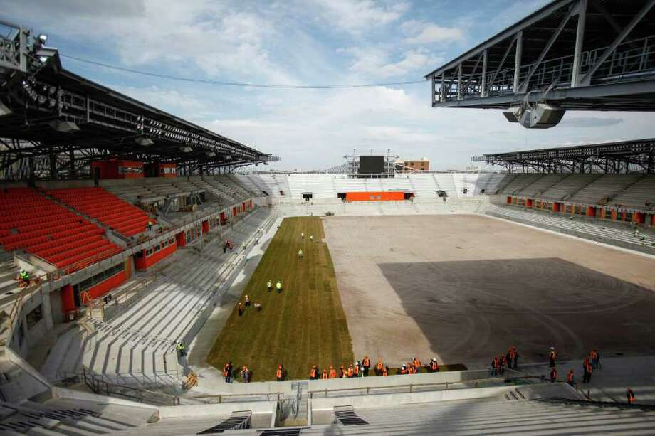 Seat installation and sod laying continues at the BBVA Compass Stadium where the Houston Dynamo soccer team will soon be playing, Wednesday, Feb. 8, 2012, in Houston.   The state-of-the-art, open-air stadium is designed to host Dynamo matches as well as additional sporting and concert events. When it opens in 2012, the 22,000-seat stadium will be the first soccer-specific stadium in Major League Soccer located in a city's downtown district. Photo: Michael Paulsen, Houston Chronicle / © 2012 Houston Chronicle