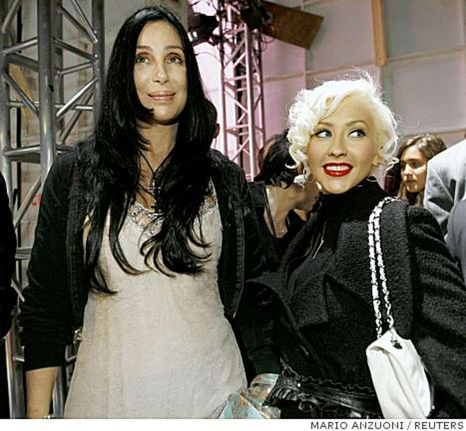 Cher (L) and Christina Aguilera pose backstage at the Agent Provocateur fashion show of the fall 2006 collection at Smashbox Studios in Culver City, California, March 20, 2006. The Los Angeles fashion week for the fall of 2006 lasts for five days and ends on Thursday. REUTERS/Mario AnzuoniRan on: 04-02-2006Kimberly Stewart (left) and Courtney Love at the Agent Provocateur show.ALSO Ran on: 01-14-2007Cher is selling the Palm Springs home she renovated. Cher (L) and Christina Aguilera pose backstage at the Agent Provocateur fashion show of the fall 2006 collection at Smashbox Studios in Culver City, California, March 20, 2006. The Los Angeles fashion week for the fall of 2006 lasts for five days and ends on Thursday. REUTERS/Mario AnzuoniRan on: 04-02-2006 Photo: MARIO ANZUONI, REUTERS