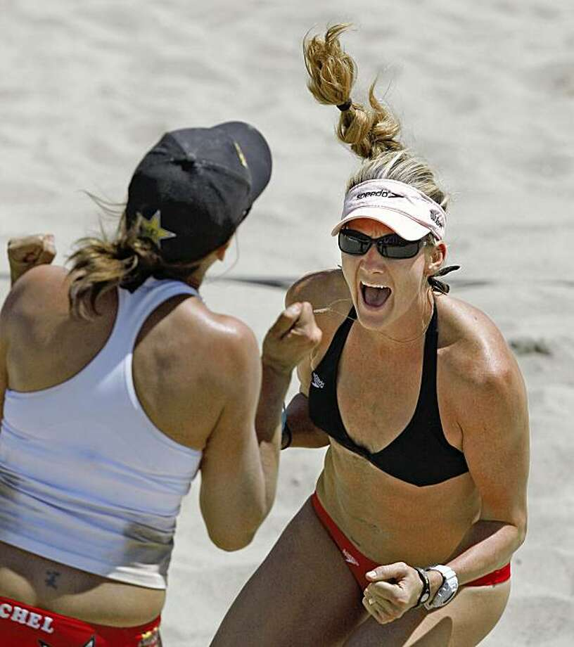 Kerri Walsh (right) celebrates with her volleyball partner Rachel Wacholder after the final point for a win over Tatiana Minello and Priscilla Lima at the AVP Crocs San Francisco's Open Pro Beach Volleyball tour held at Pier 30/32 in San Francisco, Calif on August 15, 2009.      The AVP Crocs San Francisco's Open Pro Beach Volleyball tour was held at Pier 30/32 in San Francisco, Calif., featuring Olympic gold medalist Kerri Walsh and new partner Rachel Wacholder playing Tatiana Minello and Priscilla Lima on August 15, 2009. Photo: Frederic Larson, The Chronicle