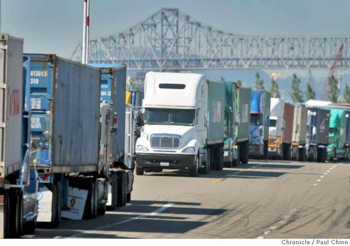 Truck drivers waited in long lines on Middle Harbor Road to pick up cargo at the Port of Oakland in Oakland, Calif. on Wednesday, Sept. 26, 2007. The Coalition for Clean and Safe Ports says dirty emissions from unsafe trucks are leading to a higher than normal level of unsafe air and is contributing to a high rate of health issues in West Oakland neighborhoods. PAUL CHINN/The Chronicle