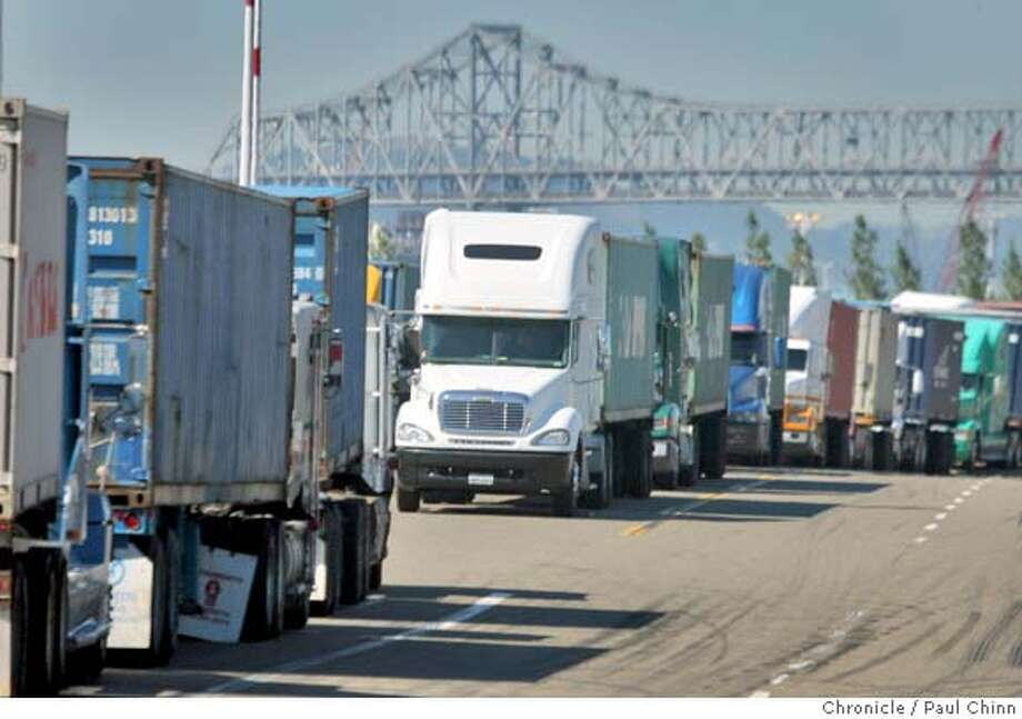 Truck drivers waited in long lines on Middle Harbor Road to pick up cargo at the Port of Oakland in Oakland, Calif. on Wednesday, Sept. 26, 2007. The Coalition for Clean and Safe Ports says dirty emissions from unsafe trucks are leading to a higher than normal level of unsafe air and is contributing to a high rate of health issues in West Oakland neighborhoods. PAUL CHINN/The Chronicle Photo: PAUL CHINN