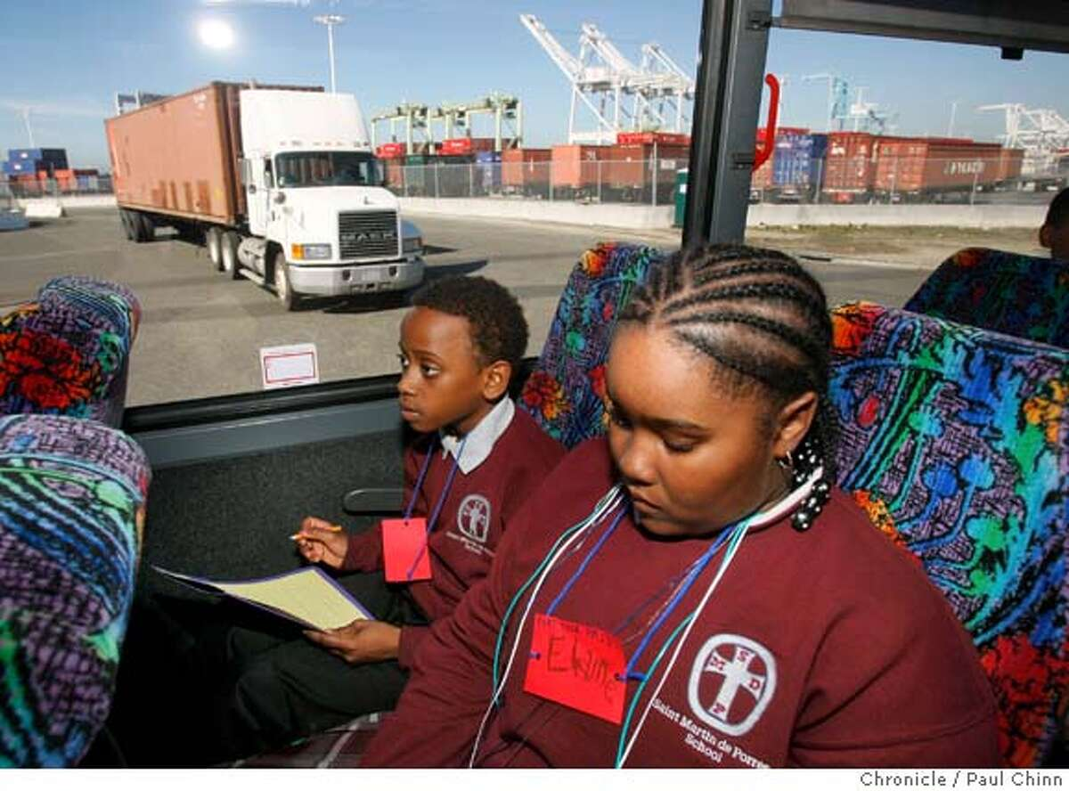 Darryl Williams, left, and Elaine Barfield take notes during a field trip of the Port of Oakland organized by a coalition of community groups for students from St. Martin de Porres Middle School in Oakland, Calif., on Thursday, Feb. 28, 2008. The bus tour focused on the rising cases of health problems in the neighborhood, including asthma, caused in large part by pollutants from trucks waiting to pick up cargo at the port. Photo by Paul Chinn / San Francisco Chronicle