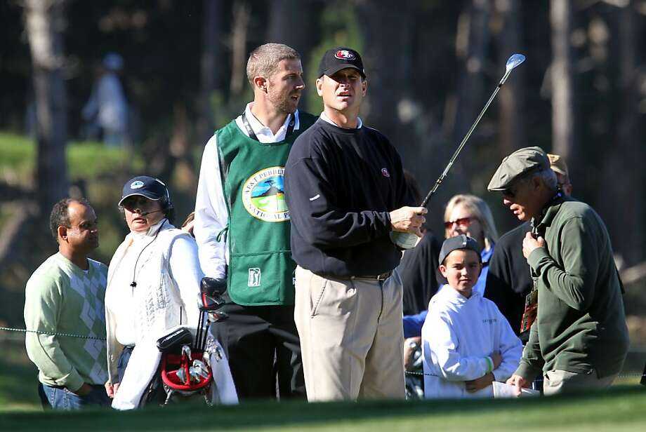 San Francisco 49ers coach Jim Harbaugh and his caddie 49ers quarterback Alex Smith wait to putt on the fifth hole during opening rounds of the annual AT&T Pebble Beach National Pro-Am golf tournament in Pebble Beach, Calif., Thursday, February 9, 2012. Photo: Lance Iversen, The Chronicle