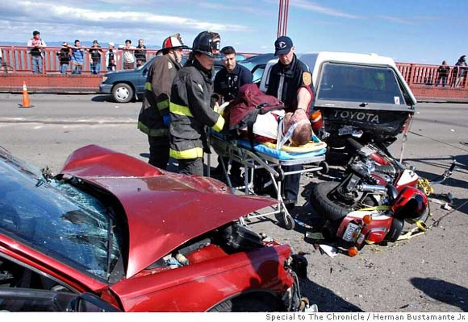 ###Live Caption:Authorities attend to a crash victims on the Golden Gate Bridge in San Francisco, Calif. on March 26, 2008 Photo by Herman Bustamante, Jr. / Special to the Chronicle.###Caption History:Crash on the Golden Gate Bridge. Photo by Herman Bustamante, Jr. / Special to the Chronicle.###Notes:###Special Instructions:Rights for each: OK for Gate and Chronicle use. No limit on repeated use. Photo: Herman Bustamante, Jr.
