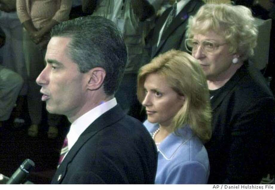 ###Live Caption:** FILE **New Jersey Gov. James. E. McGreevey addresses a news conference, as his wife, Dina Matos McGreevey, middle, and his mother, Veronica McGreevey, right, listen, at the Statehouse in this Aug. 12, 2004 file photo in Trenton, N.J. Dina Matos McGreevey knows too well what it's like to be a shell-shocked wife, standing by her man, as he confesses his sexual indiscretions on live television. (AP Photo/Daniel Hulshizer, File)###Caption History:** FILE **New Jersey Gov. James. E. McGreevey addresses a news conference, as his wife, Dina Matos McGreevey, middle, and his mother, Veronica McGreevey, right, listen, at the Statehouse in this Aug. 12, 2004 file photo in Trenton, N.J. Dina Matos McGreevey knows too well what it's like to be a shell-shocked wife, standing by her man, as he confesses his sexual indiscretions on live television. (AP Photo/Daniel Hulshizer, File)###Notes:James. E. McGreevey, Dina Matos McGreevey, Veronica McGreevey###Special Instructions:AUG. 12, 2004 FILE PHOTO Photo: Daniel Hulshizer