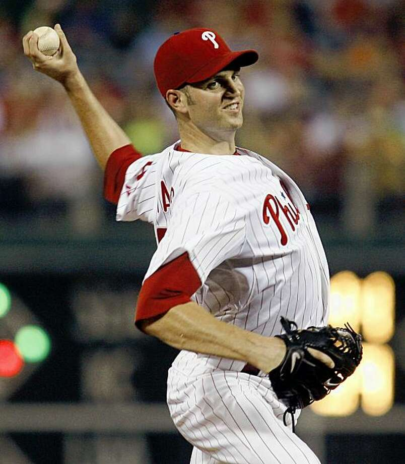 Philadelphia Phillies starting pitcher J.A. Happ throws against the Colorado Rockies in the ninth inning of a baseball game Wednesday, Aug. 5, 2009, in Philadelphia.  Happ struck out a career-high 10 in his second shutout of the season as the Phillies won 7-0. (AP Photo/H. Rumph Jr) Photo: H. Rumph Jr, AP